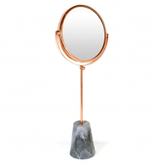 Rose-gold finish round metal mirror on foot with grey marble base 57cm