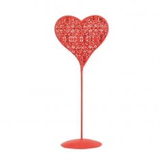 Lace-cut red metal heart on pedestal with opening
