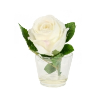 Artificial silk rose in glass vase