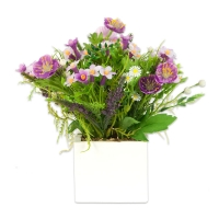 Bouquet of artificial silk flowers in a white wooden pot