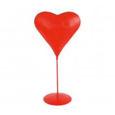 Red metal \\\'Struck by lightning\\\' heart on pedestal display on round base