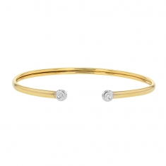 Flexible 18ct gold bangle with 0.03ct diamonds bezel set on white gold ends