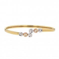 Flexible 18ct gold bangle with 6 diamonds, 4 set on white gold and 2 on rose gold