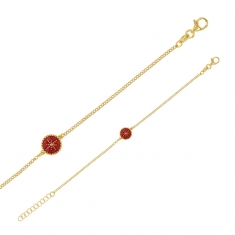 Gold-coloured sterling silver bracelet with pink enamel disc featuring a star design