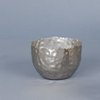 Silver coloured tea light holder in hammered finish metal